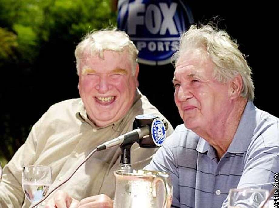 John Madden, left, NFL analyst on FOX Sports, smiles as Pat Summerall announces his retirement during a news conference Monday, July 24, 2000, in the Century City section of Los Angeles. The 2001-02 season will mark Summerall's 50th and final year with the NFL, as a player and a brodcaster. (AP Photo/Nick Ut) Photo: NICK UT