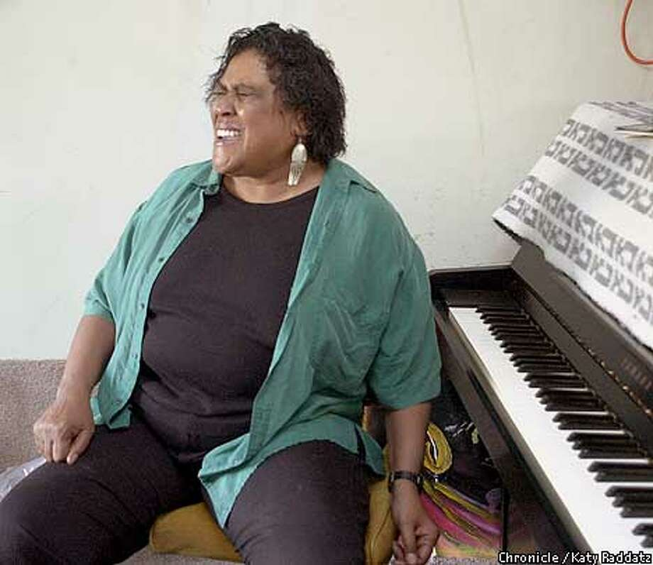 Photo by Katy Raddatz--The Chronicle  Gwen Avery, blues singer. At home working on songs in her garage/studio. She turns away from the keyboard for a minute to belt out the tune. Photo: KATY RADDATZ