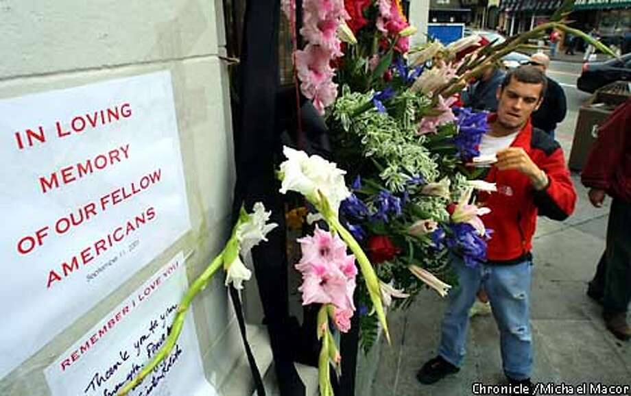 At the corner of Castro and 18th streets in San Francisco a memorial begins to grow in size. In memory of those who lost their lives in the terrorist bombings on the east coast. Local businessman Andrei Krylov builds a flower bouquet. by Michael Macor/The Chronicle Photo: MICHAEL MACOR