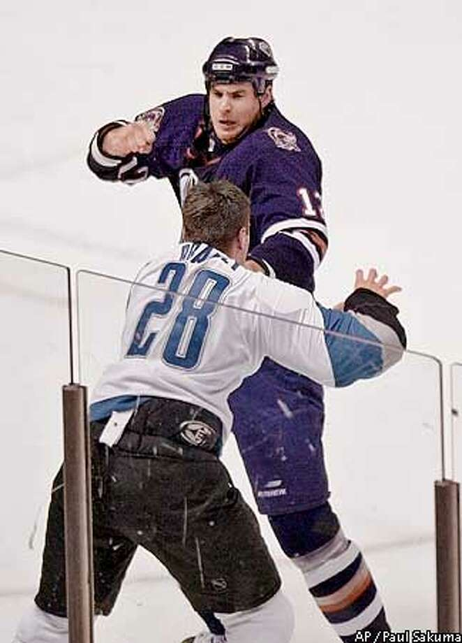 Edmonton Oilers left wing Josh Green, top, and San Jose Sharks right wing Matt Bradley (28) fight in the first period Monday, Jan. 21, 2002, in San Jose, Calif. Both were penalized for the fight. (AP Photo/Paul Sakuma) Photo: PAUL SAKUMA