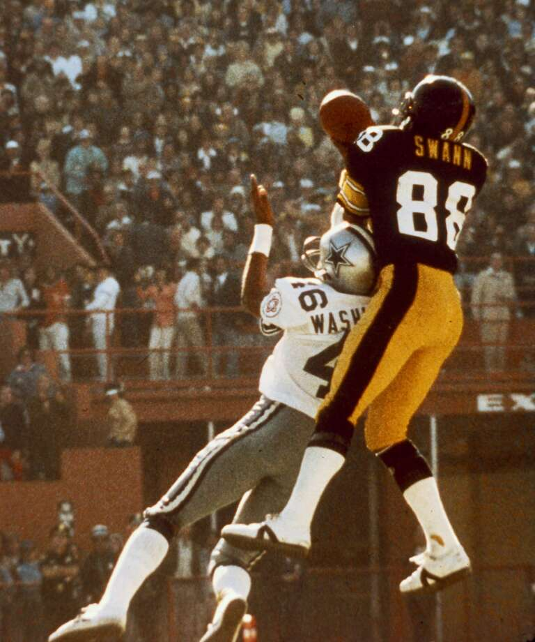 Pittsburgh Steelers wide receiver Lynn Swann goes up to make a ,catch over Dallas Cowboys cornerback Mark Washington in the Steelers 21-17 win over the Cowboys in Super Bowl X on January 18, 1976 at the Orange Bowl in Miami, Florida. (AP Photo/NFL Photos) Photo: Nfl, AP