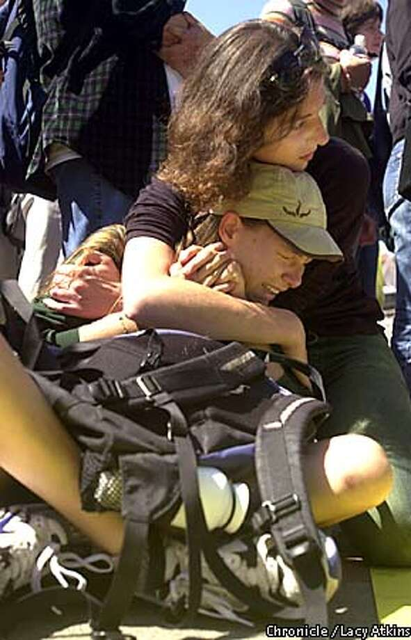 Two students comfort each other at Sproul Plaza, Tues. Sept.17 as the crowd of students gather to express theirr feeling on the attack in New York this morning.  Photo by San Francisco Chronicle Lacy Atkins Photo: Lacy Atkins
