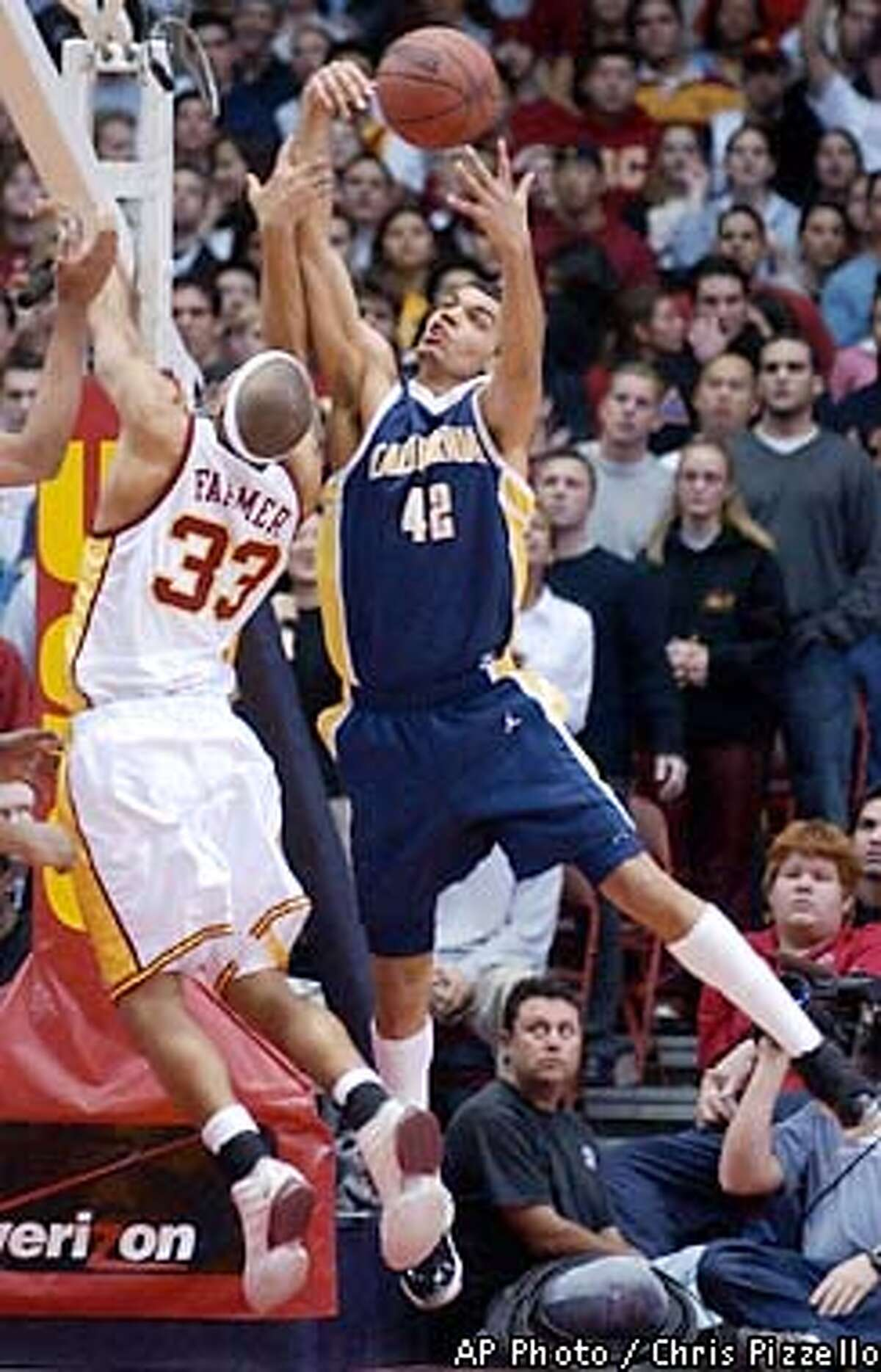California's Ryan Forehan-Kelly, right, tips a rebound away from Southern California's Desmon Farmer during the first half at the Los Angeles Sports Arena, Thursday, Jan. 24, 2002, in Los Angeles. (AP Photo/Chris Pizzello)