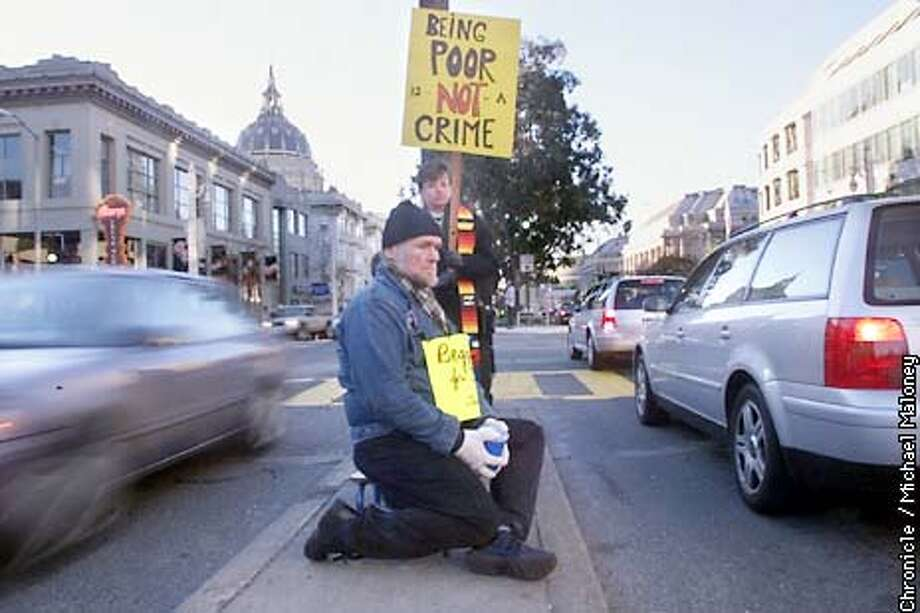 Joseph Robbins who normally panhandles in Hayes Valley joined religious leaders in a protest of Supervisor Gavin Newsom's proposed legislation that would make begging on median strips illegal. Behind Robbins is Reverend Penny Nixon of the Metropolitan Community Church in SF. Both joined about 20 others along 3 blocks of the Van Ness median strip near Golden Gate Avenue.  CHRONICLE PHOTO BY MICHAEL MALONEY Photo: MICHAEL MALONEY