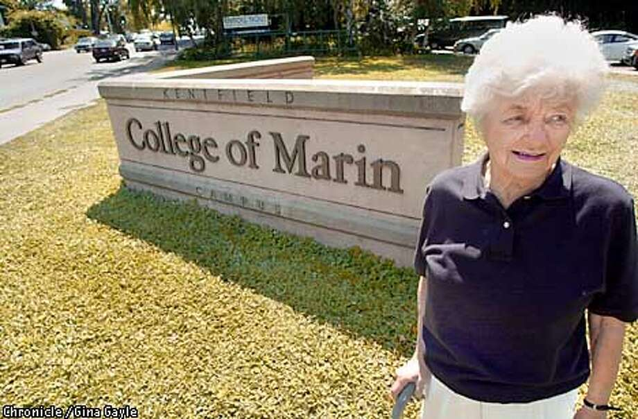 Jane Davis, a former and present student at the College of Marin stands near the main sign to the college. Jane said the college has changed a lot since she was first a student there but she likes the programs and classes they offer now. Photo by Gina Gayle/The SF Chronicle. Photo: GINA GAYLE