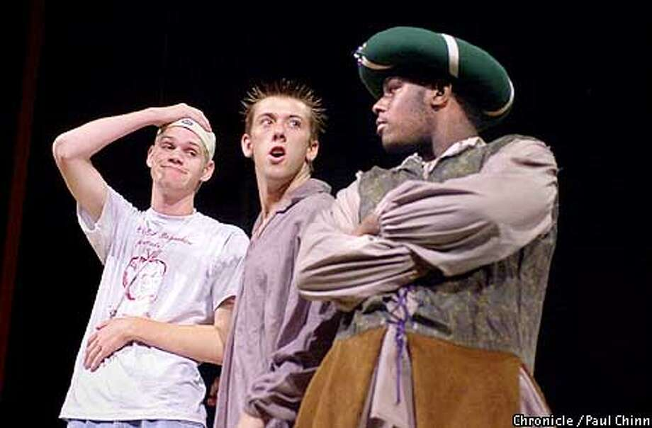"""In addition to directing his own play, Brian Moore (left) acts in another segment of the production """"The Complete Works"""" which he rehearsed with Adam Rousseu (center) and T.J. Johnson at Liberty Union High School in Brentwood.  PAUL CHINN/S.F. CHRONICLE Photo: PAUL CHINN"""