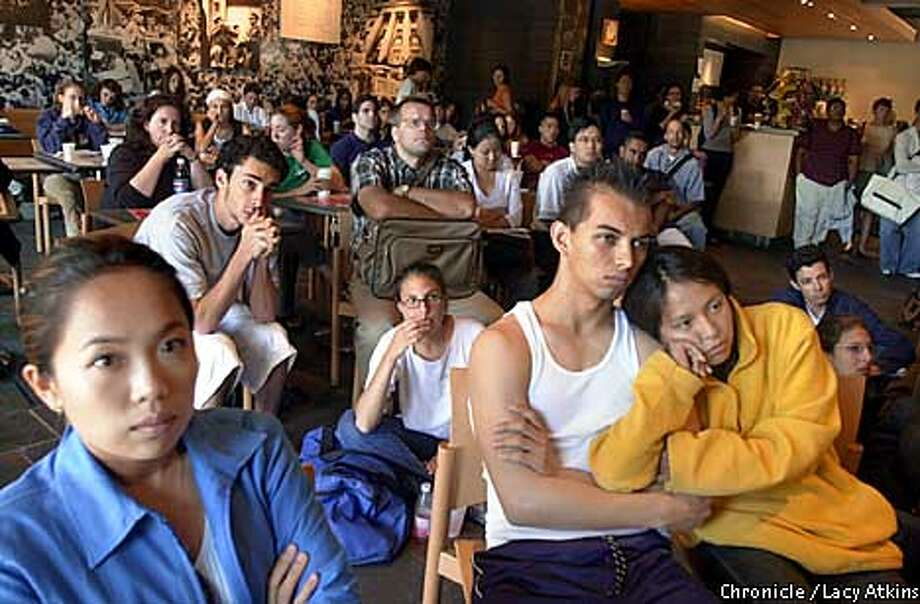Left to right--- Soo Yeon, Archie Davenport and Nancy Martinez sit among the crowd at the Free Speech Cafe, at the UC Berkeley Campus, watching CNN on the television, for the lastest on the attack in New York.  Photo by San Francisco Chronicle Lacy Atkins Photo: Lacy Atkins