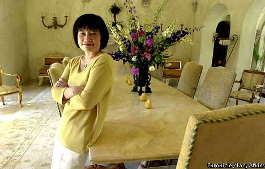 JoMei Chang, Silicon Valley entrepreneur and executive of Vitria, stand aside one of her business tables at her home in Atherton, Suday July 29,01. Photo By Lacy Atkins/SanFrancisco Chronicle Photo: Lacy Atkins