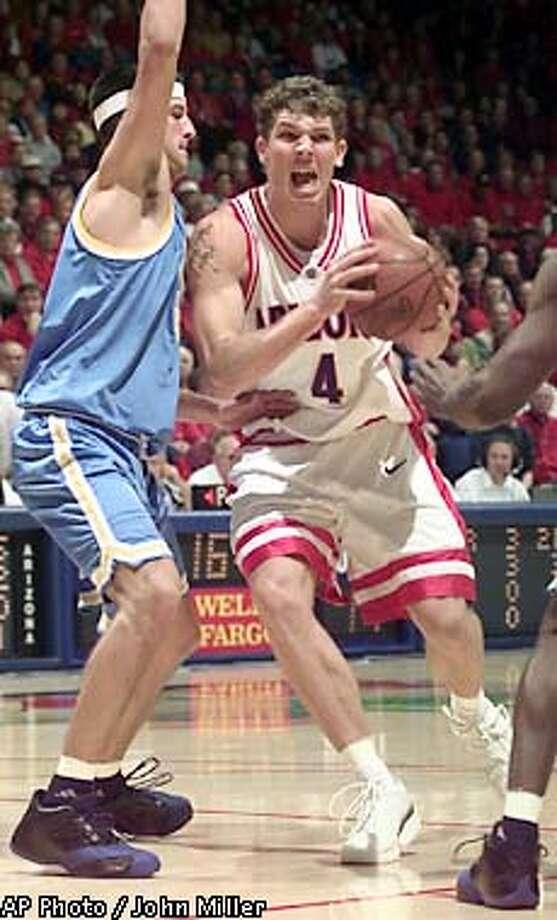 Arizona's Luke Walton (4) drives around UCLA's Jason Kapono in the first half at McKale Center in Tucson, Ariz. on Saturday, Jan. 19, 2002. Arizona beat UCLA 96-86. (AP Photo/John Miller) Photo: JOHN MILLER
