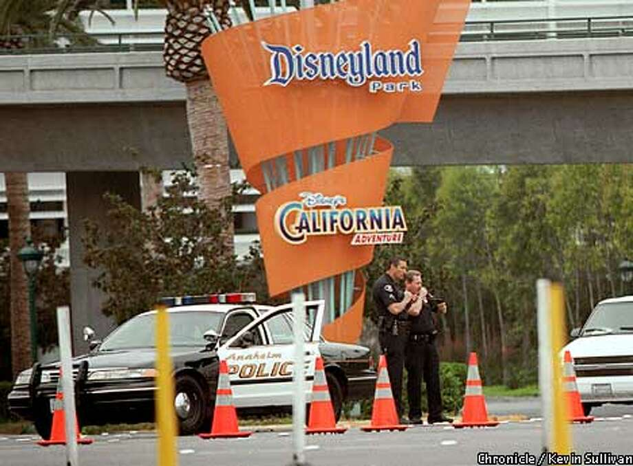 Two policeman guard the entrance of Disneyland in Anaheim, Calif., after it closed Tuesday morning following terrorist attacks in New York and in Washington. Special to The Chronicle/Kevin Sullivan, The Register (Orange County)