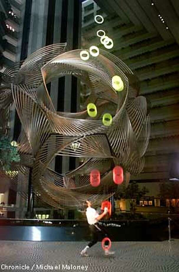 Sports juggler, Albert Lucas attempted a new world record of juggling 14 rings at the Hyatt Regency Atrium Lobby this morning. According to physicists, 14 rings is the maximum amount possible. Lucas holds the current world record at 12. The 30-foot Eclipse Sculpture is in the background.  CHRONICLE PHOTO BY MICHAEL MALONEY Photo: MICHAEL MALONEY