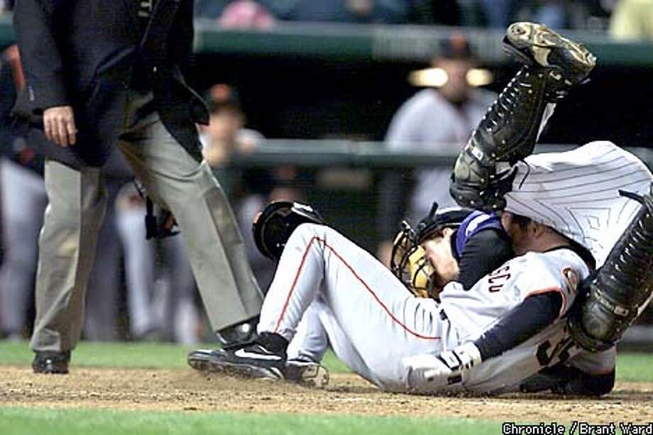 Rich Aurilia and Colorado catcher Gary Bennett crashed into each other but Aurilia scored the tying run in the eigth inning on a double by Barry Bonds. By Brant Ward/Chronicle Photo: BRANT WARD