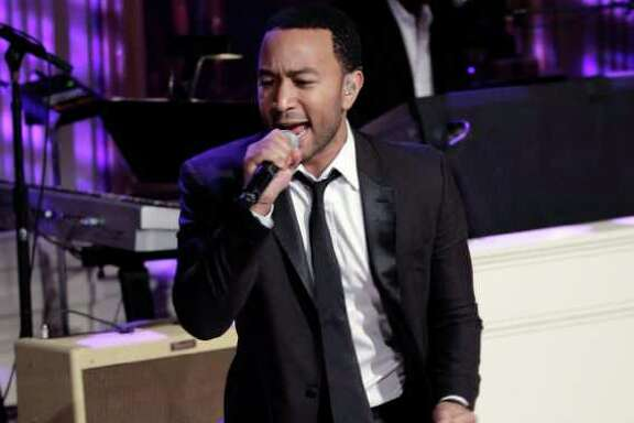 """FILE - In this Feb. 24, 2011 file photo, singer John Legend performs during the White House Music Series saluting Motown in the East Room of the White House in Washington. Legend is joining the Kennedy Center in Washington to start a program in honor of the late Marvin Gaye encouraging young artists to engage in social issues. The project announced Tuesday echoes Gaye's lyrics and asks young people to consider """"What's Going On ... Now?"""" They can upload videos, photos, poems, music or any recordings of creative expression to the project's website to answer that question. (AP Photo/Pablo Martinez Monsivais)"""