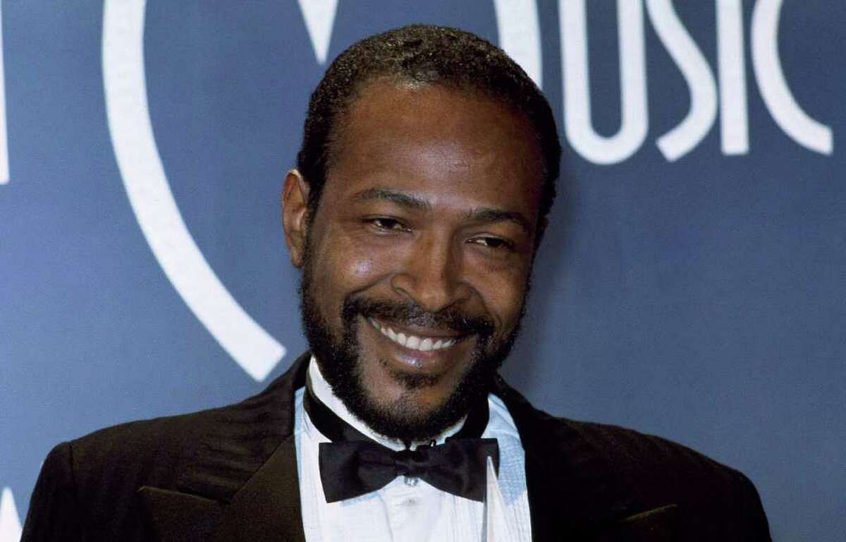 """FILE - In this Jan. 17, 1983 file photo, Singer-songwriter Marvin Gaye is seen at the American Music Awards in Los Angeles. Singer John Legend is joining the Kennedy Center in Washington to start a program in honor of the late Marvin Gaye encouraging young artists to engage in social issues. The project announced Tuesday echoes Gaye's lyrics and asks young people to consider """"What's Going On ... Now?"""" They can upload videos, photos, poems, music or any recordings of creative expression to the project's website to answer that question. (AP Photo/Doug Pizac)"""