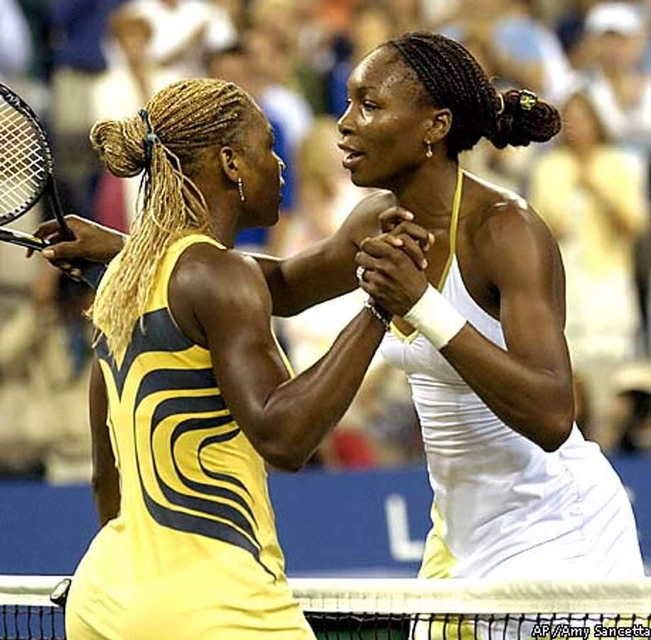 Venus Williams, right, and her sister, Serena, hug at the net after Venus defeated Serena in the U.S. Open womens singles final in New York Saturday Sept. 8, 2001. (AP Photo/Amy sancetta) Photo: AMY SANCETTA