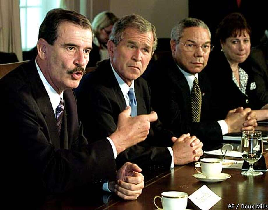 Mexican President Vicente Fox,left, makes a statement to reporters with President Bush looks on during a bilateral meeting in the Cabinet Room at the White House in Washington Wednesday, Sept. 5, 2001. Also seen are Secretary of State Colin Powell and Secretary of Agriculture Ann Veneman. (AP Photo/Doug Mills) Photo: DOUG MILLS