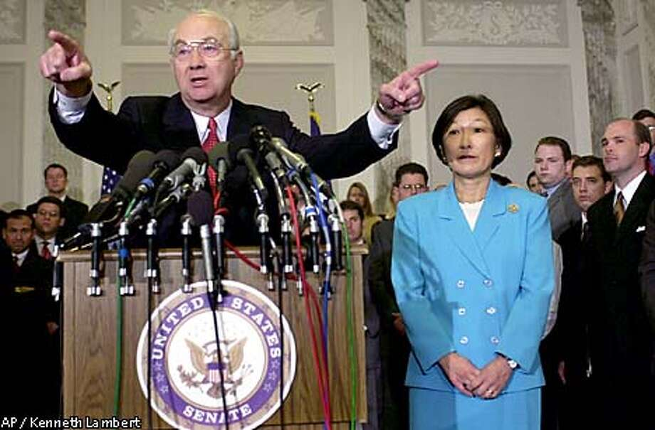Sen. Phil , R-Texas, with wife Wendy at his side, calls on reporters after announcing he will give up his Senate seat, and not seek re-election, during a news conference on Capitol Hill, Tuesday, Sept. 4, 2001, in Washington. (AP Photo/Kenneth Lambert) Photo: KENNETH LAMBERT