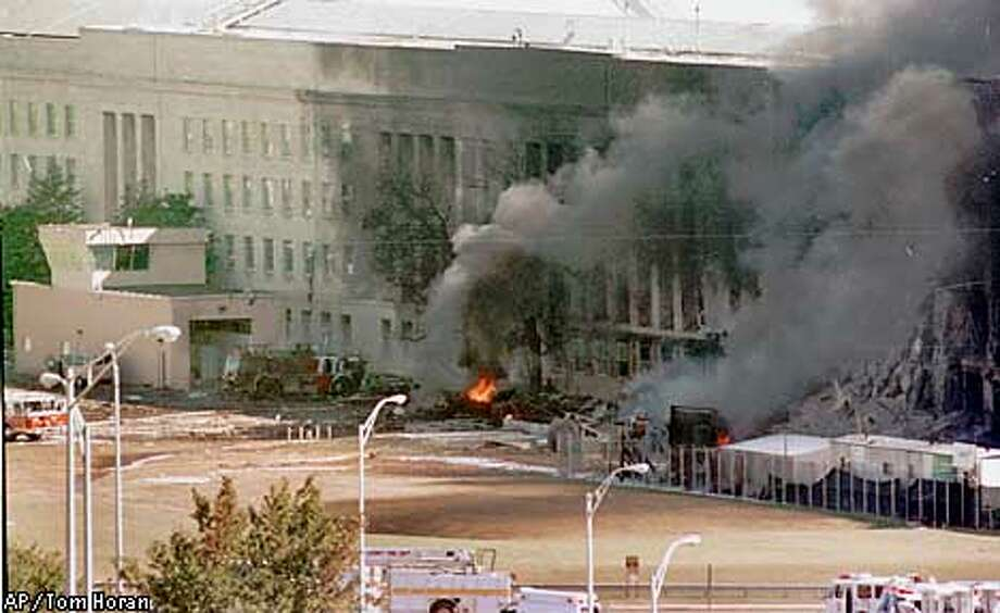 The south side of the Pentagon burns Tuesday, Sept. 11, 2001 as seen from atop the River House Apartments in Arlington, Va. (AP Photo/Tom Horan) Photo: TOM HORAN