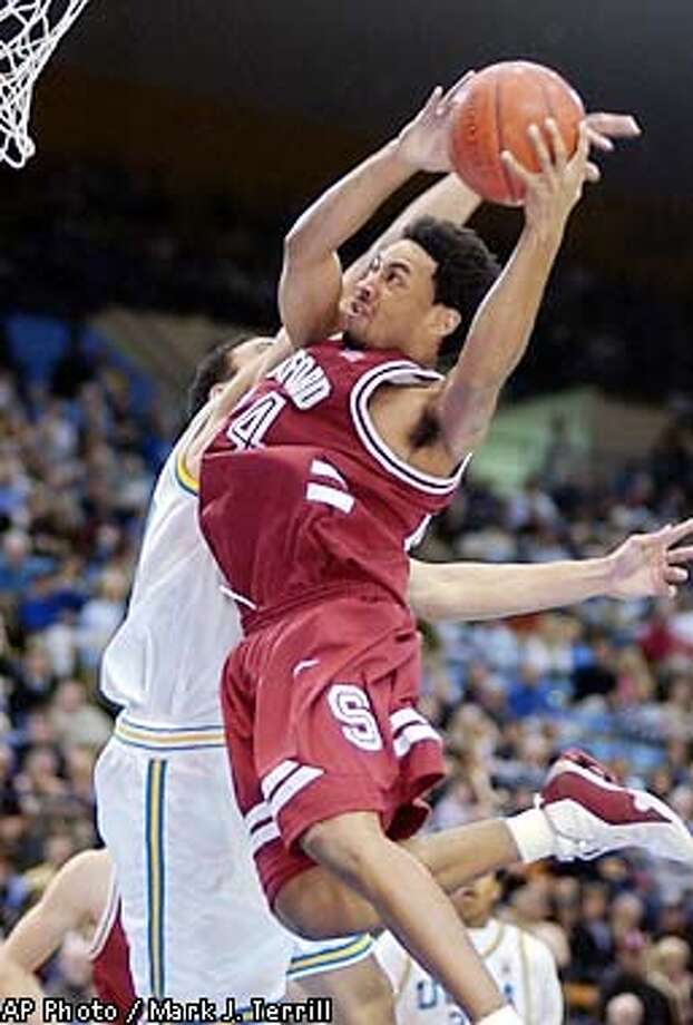 Stanford's Julius Barnes shoots as UCLA's Dan Gadzuric tries to block during the first half Thursday night, Jan. 24, 2002, in Los Angeles. (AP Photo/Mark J. Terrill) Photo: MARK J. TERRILL