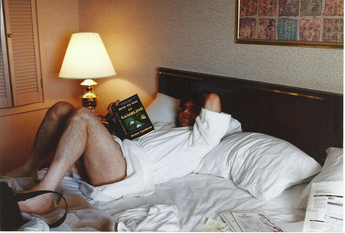"""Keith Raniere at a Las Vegas hotel in the 1990s reading """"How to Win at Gambling"""""""