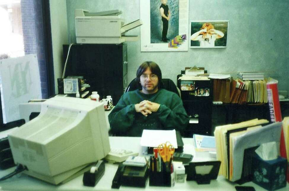 Keith Raniere in the mid-1990s in his office at National Health Network at the former Rome Plaza, Route 9, Clifton Park. (TheFallofNXIVM.com).