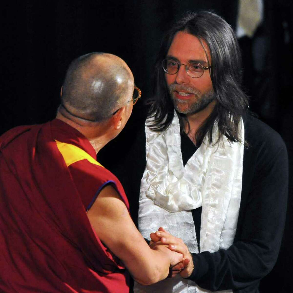 The Dalai Lama speaks onstage with Keith Raniere, right, co-founder of Executive Success Programs, Inc. (ESP), after giving him a Tibetan scarf following his talk at the Palace Theatre, in Albany, N.Y., Wed., May 6, 2009. (Philip Kamrass / Times Union)
