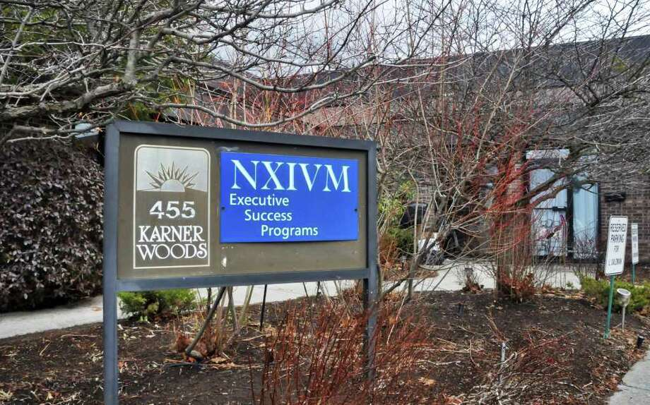 Sign outside the NXIVM offices at 455 New Karner Road in Colonie, Tuesday afternoon, Jan. 26, 2010. (John Carl D'Annibale / Times Union) Photo: John Carl D'Annibale / 00007312A