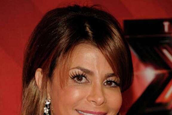 """FILE - In this Dec. 22, 2011 file photo, singer Paula Abdul poses on the red carpet at The X Factor Finale show in Los Angeles. Abdul said she's leaving """"The X Factor"""" after one season as judge. (AP Photo/Dan Steinberg, file)"""