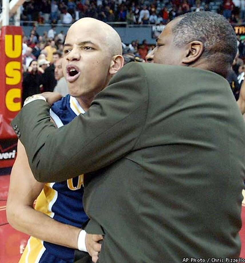 California's Shantay Legans is embraced by assistant coach Louis Reynaud as he celebrates his game-winning 3-pointer in overtime against Southern California at the Los Angeles Sports Arena, Thursday, Jan. 24, 2002, in Los Angeles. California edged USC 92-91. (AP Photo/Chris Pizzello) Photo: CHRIS PIZZELLO