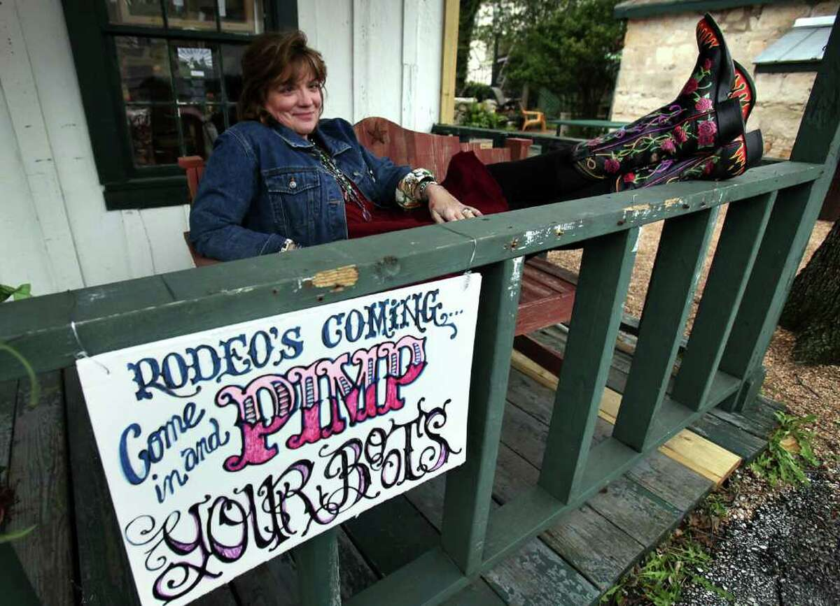 Kathleen Kridler sits on the front porch of her Boerne studio, Gypsy Bluebird Studio.