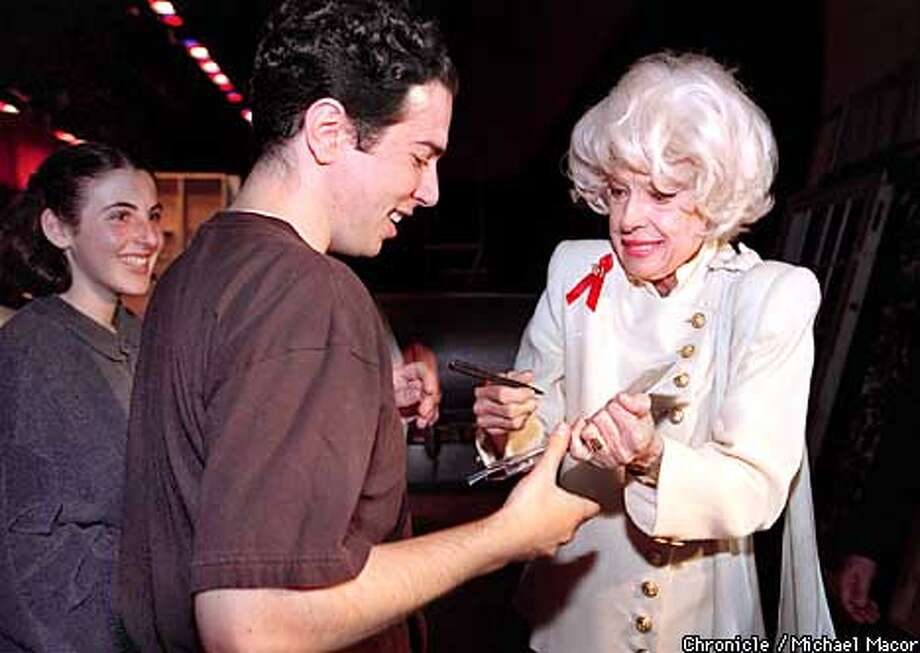 LOWELL 2/02MAY95/MN/MACOR Stage star Carol Channing visits her old high school LOWELL in San Francisco to talk with drama students. Channing signs an autograph for following the talk. Chronicle Photo: Michael Macor