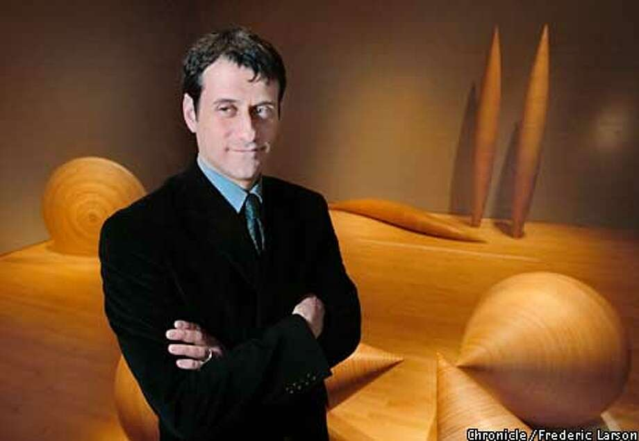 : Joe Rosa the new curator for SFMOMA architecture -- a post that the last guy, Aaron Betsky, made controversial thus views on things like height limits. Rosa among Donald Fortescue art pieces. Chronicle photo by Frederic Larson Photo: FREDERIC LARSON