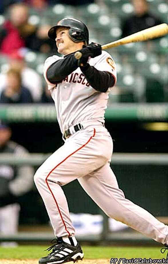 San Francisco Giants Jeff Kent watches his solo home run clear the wall in the seventh inning off of Colorado Rockies relief pitcher Justin Speier at Coors Field in Denver on Saturday, Sept. 8, 2001. Kent was 3 for 5 and had three RBI's as the Giants beat the Rockies 7-3.(AP Photo/David Zalubowski) Photo: DAVID ZALUBOWSKI
