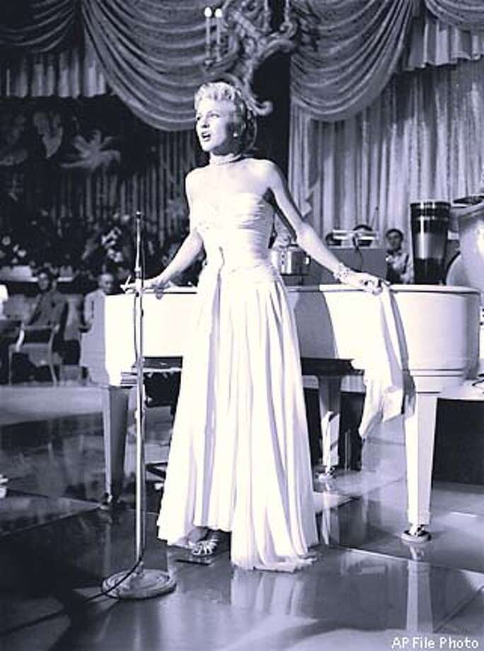 "FILE--Singer Peggy Lee, who makes her first screen appearance in ""The Jazz Singer"", is shown Sept. 26, 1952, as she runs through a number at a recording session on a studio sound stage in Hollywood. Lee, the singer-composer whose smoky, insinuating voice in such songs as ``Is That All There Is?'' and ``Fever'' made her a jazz and pop legend, died Monday, Jan. 21, 2002. She was 81. (AP Photo)"