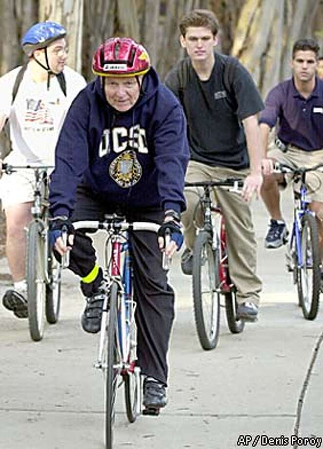 Richard Riordan, the GOP candidate for governor, led a bicycle tour Wednesday of the University of California at San Diego campus. Associated Press photo by Denis Poroy