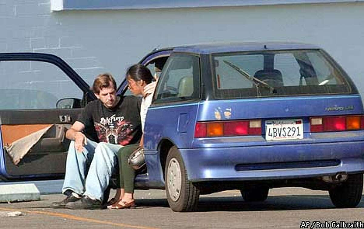 A woman whom Sacramento police identified as a relative of a shooting victim is consoled by a friend near Miller Park in Sacramento, Calif. Sunday Sept. 9, 2001. Police believe disgruntled former security guard Joseph Ferguson, 20, of Sacramento, shot and killed three unarmed ex-coworkers and a fourth man Saturday night, then handcuffed another guard and fled in her car. (AP Photo/Bob Galbraith)