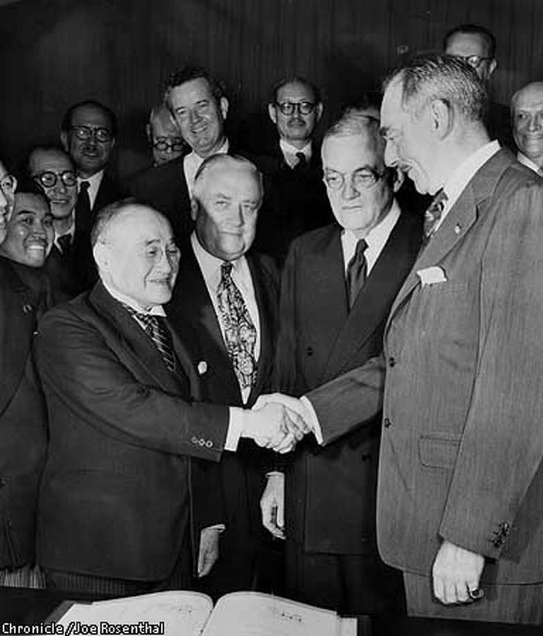 PHOTO BY JOE ROSENTHAL  JAPANESE FOREIGN MINISTER SHIGERU YOSHIDA SHAKES HANDS WITH US SECY OF STATE DEAN ACHESON, WHO IS ALSO THE CHAIRMAN OF THE PEACE CONFERENCE. JOHN FOSTER DULLES, WHO WAS THE CHIEF ARCHITECT OF THE TREATY (2ND FROM RIGHT, GLASSES) WATCHED. DULLES, A REPUBLICAN IN THE DEMOCRATIC TRUMAN ADMINISTRATION WAS LATER SECY OF STATE HIMSELF UNDER EISENHOWER Photo: HANDOUT