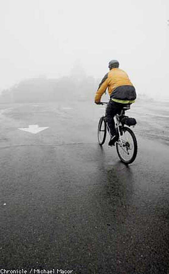 Brian Zittel of Concord climbs the last hill at the summit of Mt. Diabl State Park, where the Summit building is covered in rain and fog. temperature is 37 degrees with snow possible overnight. by Michael Macor/The Chronicle Photo: MICHAEL MACOR