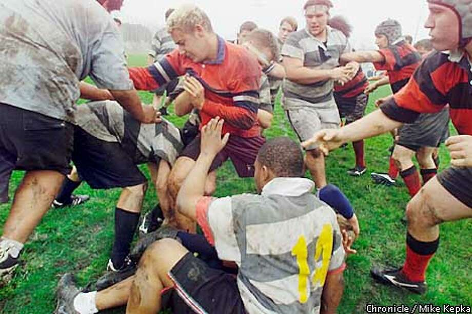 Good, Clean Fun?: Erik Garland, 16, (center) of Diablo Youth Rugby Team, scrambles for the ball during a match against the Berkeley Rhinos at San Pablo Park in Berkeley. Chronicle photo by Mike Kepka