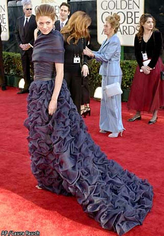 "Actress Debra Messing, nominated for best actress in a television series comedy or musical category for her role in ""Will & Grace,"" arrives at the 59th Annual Golden Globe Awards in Beverly Hills, Calif., Sunday, Jan. 20, 2002. (AP Photo/Laura Rauch) Photo: LAURA RAUCH"
