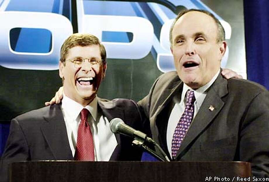 "Former New York City Mayor Rudolph Giuliani, right, shares a happy moment with California Republican gubernatorial candidate Bill Simon, a former Giuliani assistant when both were federal prosectors, at a news conference before a Simon fundraising luncheon Thursday, Jan. 17, 2002, at the Century Plaza Hotel in Los Angeles. "" California could not get a better man than Bill Simon,"" Giuliani said. Simon, now a Los Angeles businessman, is seeking the GOP nomination to face incumbent Democrat Gray Davis. Simon trails former Los Angeles Mayor Richard Riordan and Secretary of State Bill Jones in the most recent statewide poll. (AP Photo/Reed Saxon) Photo: REED SAXON"