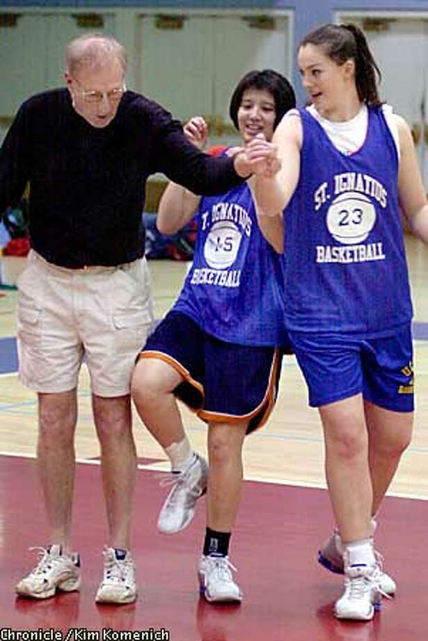 Two St. Ignatius girls basketball players are heading to top universities on scholarships. Center Maureen McCaffrey (#23) is going to Harvard and guard Katie Meinhardt (#15) is going to Boston University. L to R, assistant coach Bob Drucker shows Meinhardt and McCaffrey a blocking move.  CHRONICLE PHOTO BY KIM KOMENICH Photo: KIM KOMENICH