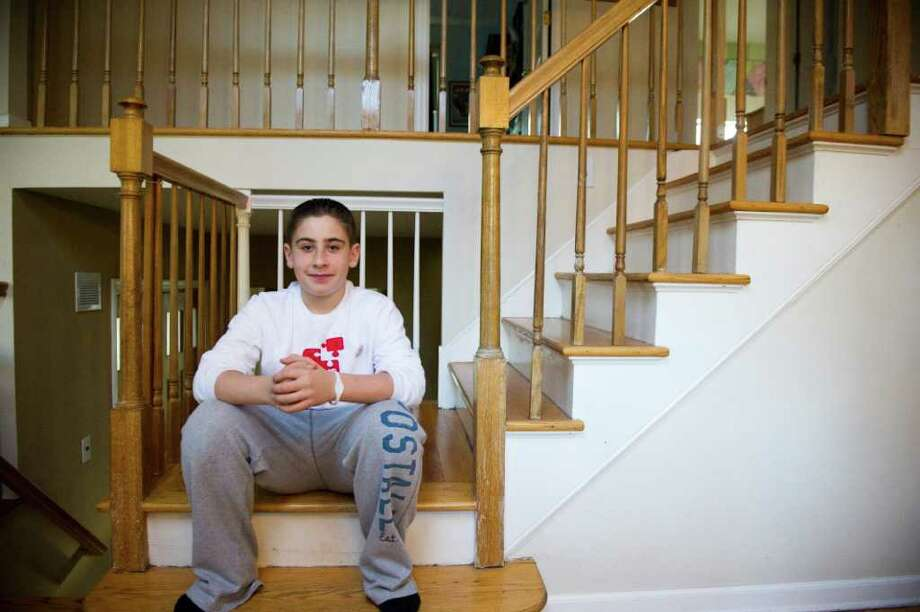 Justin Wexler, 12, in his home in Stamford, Conn., January 31, 2012.  Wexler is organizing a bone marrow donor drive for his bar mitzvah project. Photo: Keelin Daly / Stamford Advocate