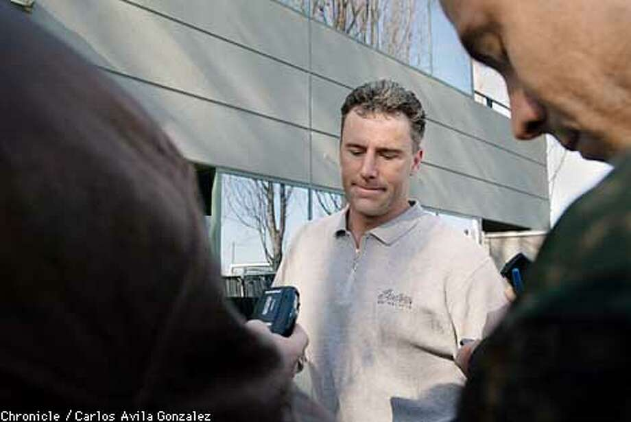 A disappointed Raiders's quarterback, Rich Gannon, speaks to media outside the Raiders headquarters in Alameda, on Sunday, January 20, 2002, the day after the team's season came to an end with their loss to the New England Patriots.  (BY CARLOS AVILA GONZALEZ/THE SAN FRANCISCO CHRONICLE) Photo: CARLOS AVILA GONZALEZ