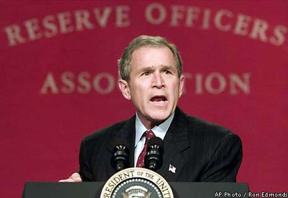 President Bush makes remarks, Wednesday, Jan. 23, 2002, to the Reserve Officers Association lucncheon in Washington. Bush propose a $48 billion increase in military spending for fiscal 2003, the largest increase in two decades. (AP Photo/Ron Edmonds) Photo: RON EDMONDS