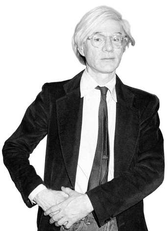 "** FILE ** Pop artist Andy Warhol poses in front of a portrait of himself at the show Andy Warhol and Jamie Wyeth: Portraits of Each Other at the Coe Kerr Gallery in New York in this June 3, 1976 photo. Warhol is coming to Brattleboro, Vt. ""Andy Warhol: Intimate & Unseen'' will open Sept. 18 at the Brattleboro Museum & Art Center. The exhibit will feature works collected by Paramount Pictures executive Jon Gould, who was Warhol's companion during the early 1980s. Photo: AP / AP"