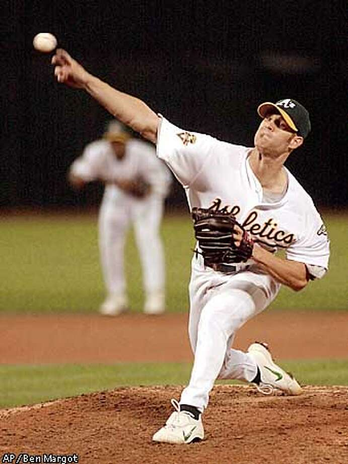 Oakland Athletics' Tim Hudson releases against the Baltimore Orioles' in the fifth inning Monday, Sept. 3, 2001, in Oakland, Calif. (AP Photo/Ben Margot) Photo: BEN MARGOT