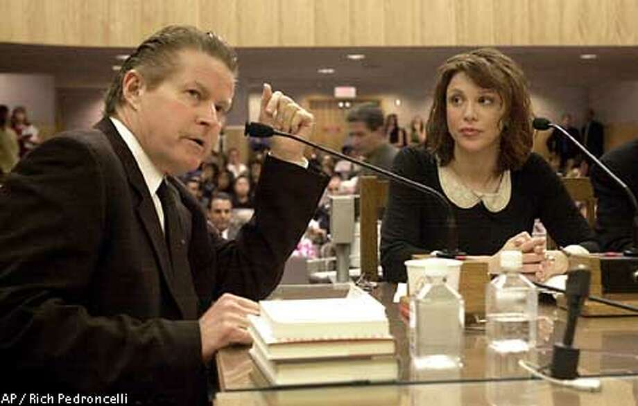 Recording artist Don Henley, left, testifes about personal service contracts with record companies during a hearing of the Senate Select Committee on Entertainment Industry, held at the Capitol in Sacramento, Calif., Wednesday, Sept. 5, 2001. Henley, along with Courtney Love, right, and other recording artists, contend that record companies unfairly control their careers due to a 1987 ammendment to the Seven-Year Statute that allows the record industry to tie them to record labels for longer then theircontracts. (AP Photo/Rich Pedroncelli) Photo: RICH PEDRONCELLI