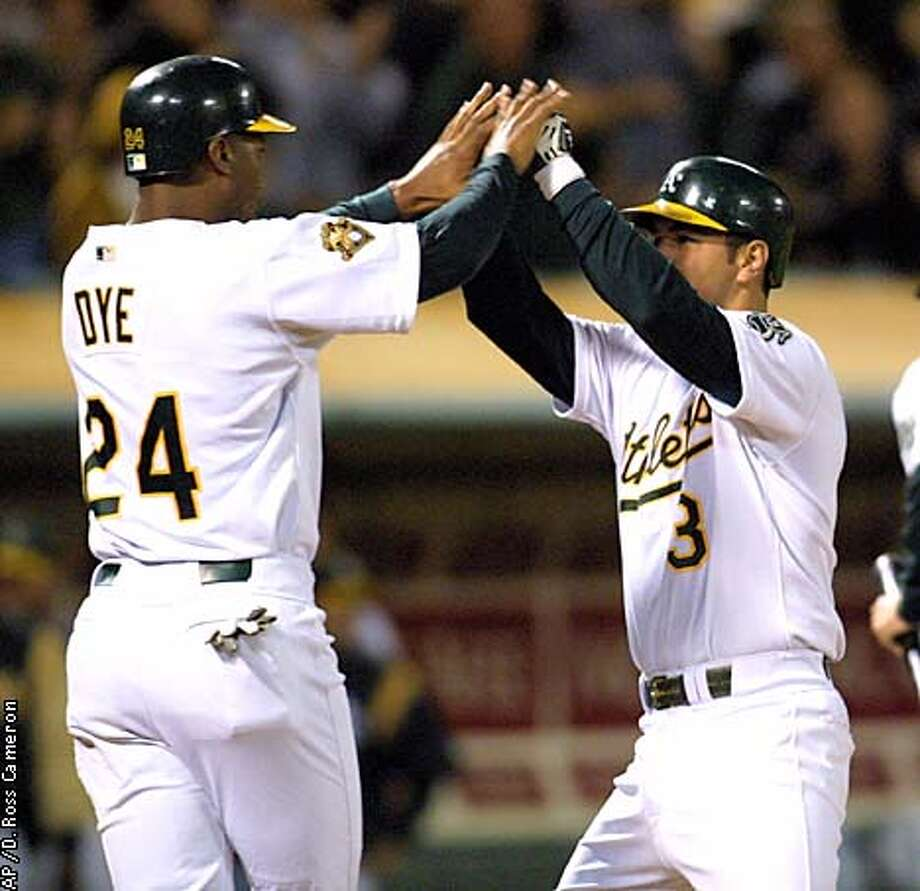 Oakland Athletics' Eric Chavez, right, is congratulated by Jermaine Dye after hitting a two-run homer in the fourth inning off Tampa Bay Devil Rays' Bryan Rekar on Friday, Sept. 7, 2001, in Oakland, Calif. (AP Photo/D. Ross Cameron) Photo: D. ROSS CAMERON