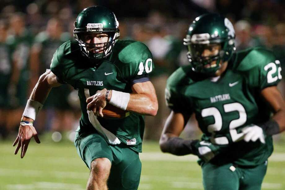 Reagan running back Elijah Ball (right) leads the way for quarterback Trevor Knight during their Class 5A Division II quarterfinal playoff game with Steele at Heroes Stadium on Dec. 3, 2011.  Steele advanced to the next round with a 35-10 victory over the Rattlers.  Photo by Marvin Pfeiffer Photo: MARVIN PFEIFFER, SAEN / Prime Time Newspapers 2011